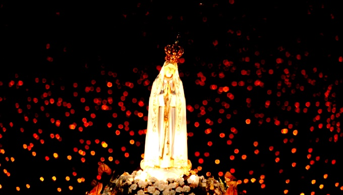 STATUE OF MARY CARRIED IN CANDLELIGHT VIGIL